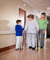Person using a walker, photo source:  walker with tennis balls istockphoto 00001924470