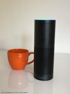 Amazon Echo (Alexa) next to large coffee cup for size comparison